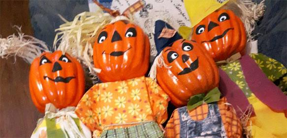 photo of mini scare crows with pumpkin heads