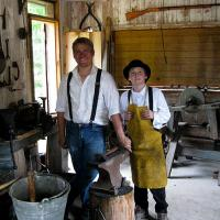 photo of blacksmith with young apprentice